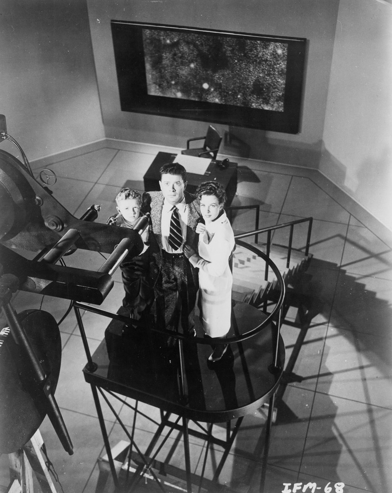 The interior of Kelston's observatory from Invaders from Mars. Left to right, Arthur Franz as astronomer Stuart Kelston, Jimmy Hunt as David MacLean and Helena Carter as psychologist Patricia Blake. Click to enlarge.