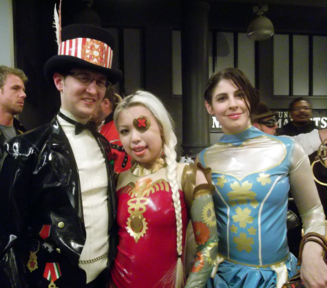 Models pose in their Steampunk Caduceus Latex Tattoo Art outfits. Artist: Dawn Mostow