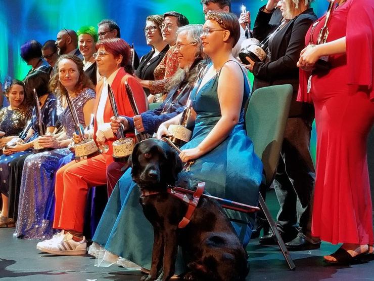 Elsa Sjunneson-Henry and her guide dog, Pax, alongside the asembled 2019 Hugo winners. (Photo: Jonathan Henry)