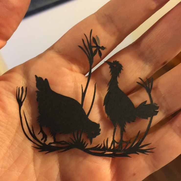 Cutout design of two chickens for Kathleen Jennings' Flyaway