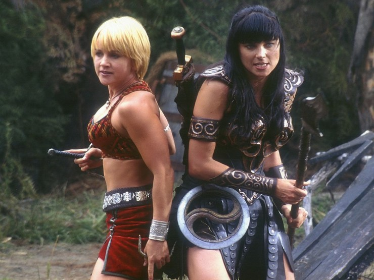 Xena and Gabrielle fighting back to back
