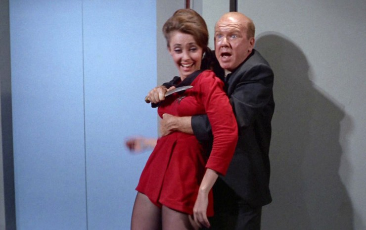 Star Trek, Wolf in the Fold, Jack the Ripper inhabiting alien and threatening crew member with knife while she laughs