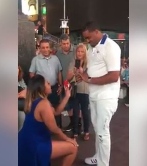 %name Video: Daring Girlfriend Kneels Down and Proposes to Boyfriend Before a Large Crowd
