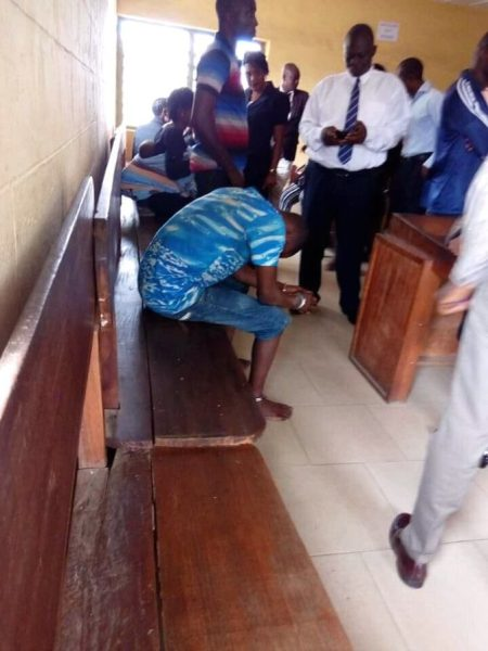 suspected internet fraudster who allegedly killed his girlfriend and used her for money ritual couldn't hold back tears after being remanded in prison.