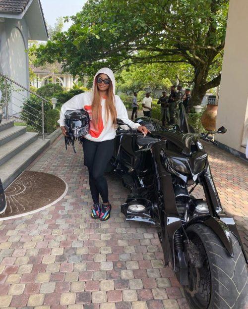Tacha cruising on powerbike with Donald Duke