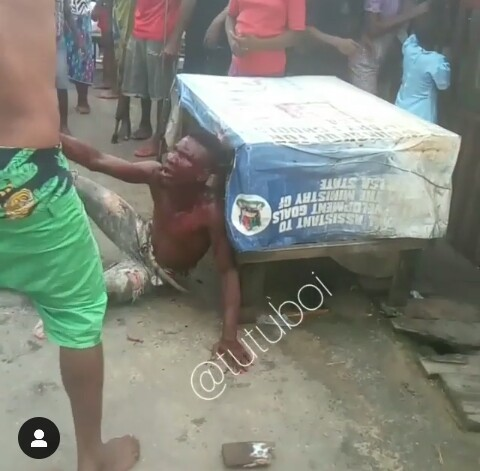 The thief being planked by the mob