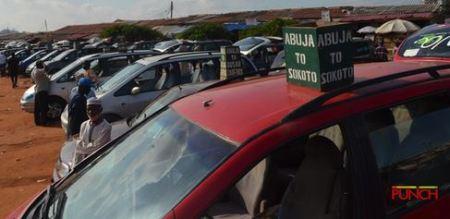 Abuja%20park1 - Passengers Besiege Abuja Park As FG Lifts Interstate Journey Ban (Photographs)