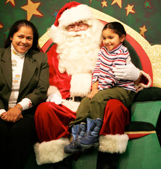 Jini and daughter Aliya sit with Santa
