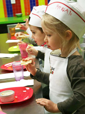 Children enjoying their final product after a class at the Rising Chefs Culinary Centre.