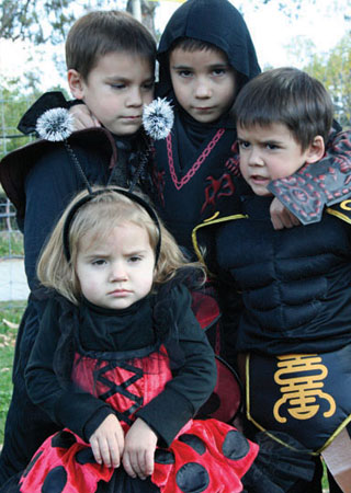 Siblings Mason, 5; Phoenix, 7; Jagger, 4, and Morrisan, 2, look scary in their Halloween costumes.