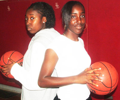 West Hill's senior girls basketball team captain Sally Asante, right, and teammate Grace Kusi are a well-rounded duo.