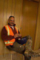 Site supervisor Rick Sheppard takes a break inside the office at the construction site of the plaza. (Gesilayefa Azorbo/Toronto Observer)
