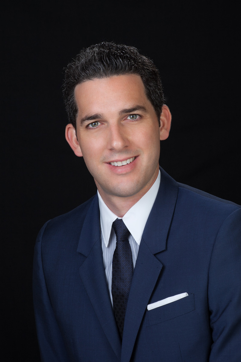 Business portrait of man with blue suit and black background