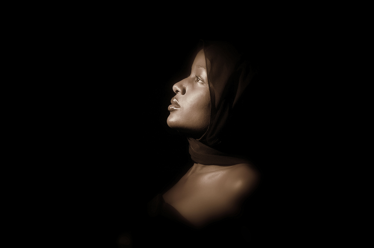 Fashion portrait of women coming out of the darkness in Sepia tone