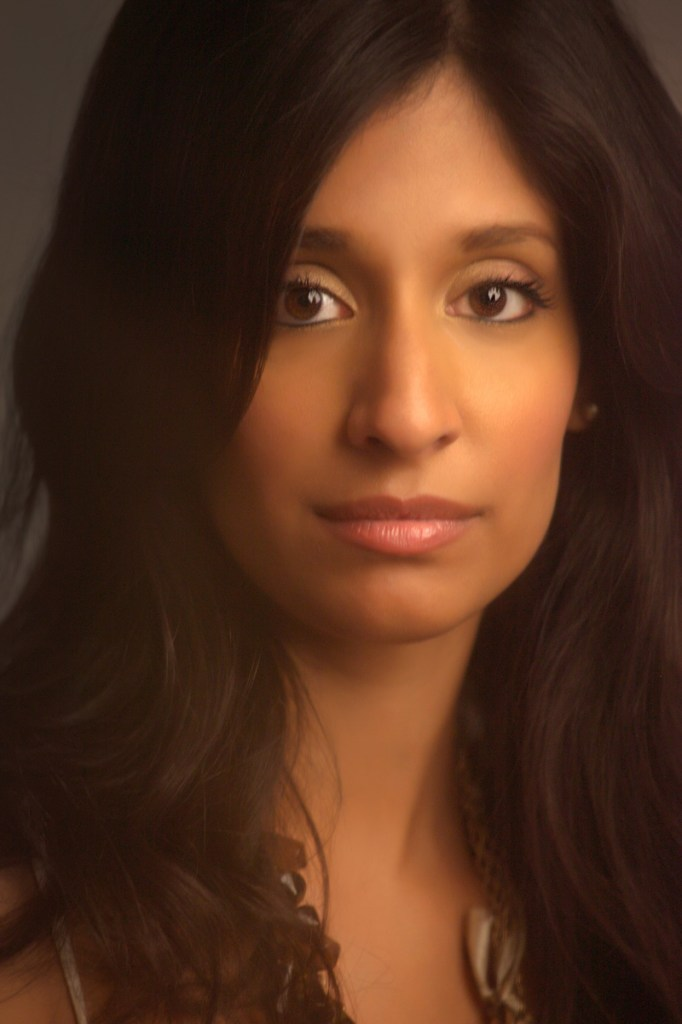 Female headshot with warm lighting taken in professional studio