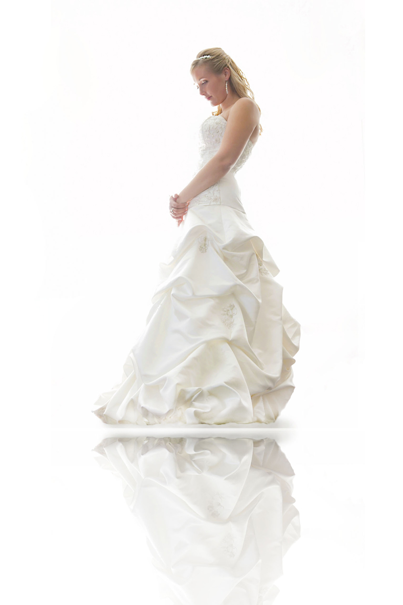 Bride with anglic white background standing on glass