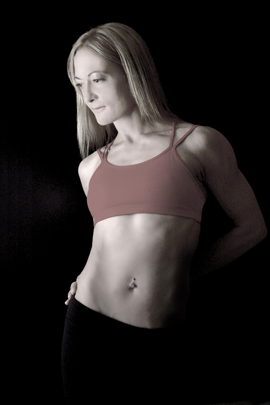 portrait of fitness model with red top taken in photo studio Toronto