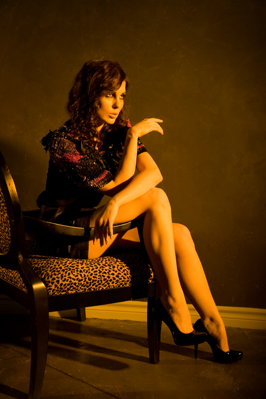 fashion portrait of women sitting in chair with warm tones