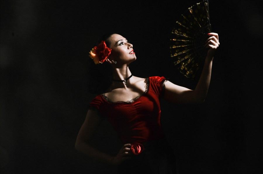 Personal branding photo of Flamenco dancer with dark background taken in photo studio