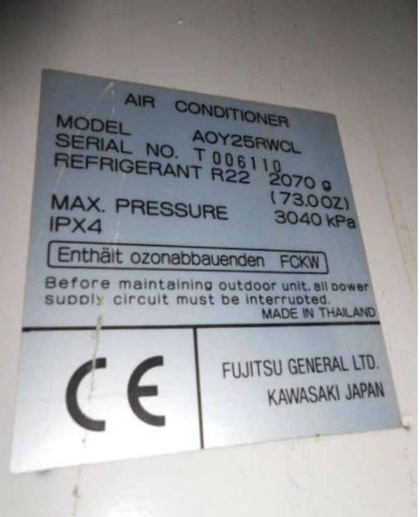 An air conditioning condensing unit data plate showing R22 refrigerant charge