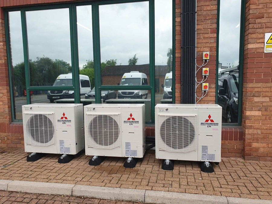 3 air conditioning outdoor condenser units