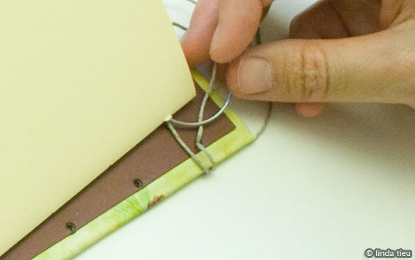 Sewing first signature with cover