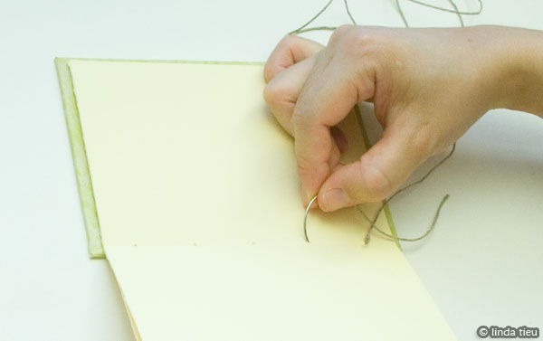 Continue sewing your book