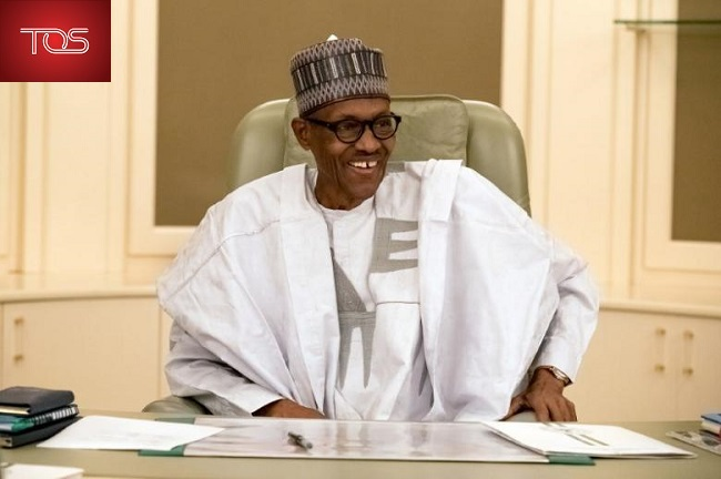 Nigeria's President Muhammadu Buhari smiles as he resumes work following seven weeks of medical leave, in Abuja