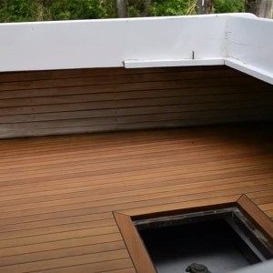 Boat deck being finished with TotalBoat Danish Teak Sealer