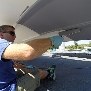 TotalBoat TotalProtect being applied with a roller