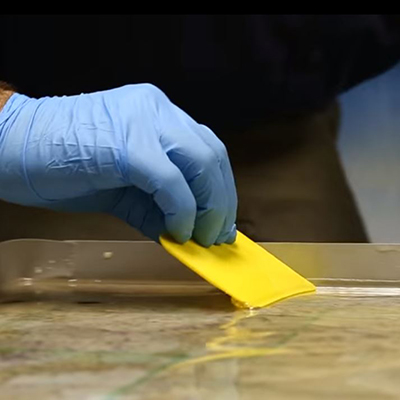 TotalBoat TableTop Epoxy spreading resin during flood coat