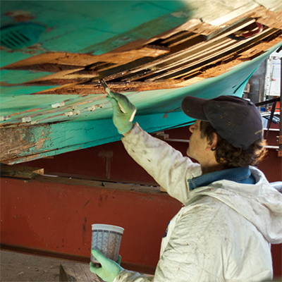 Applying TotalBoat Penetrating Epoxy Sealer to Rotted Wood