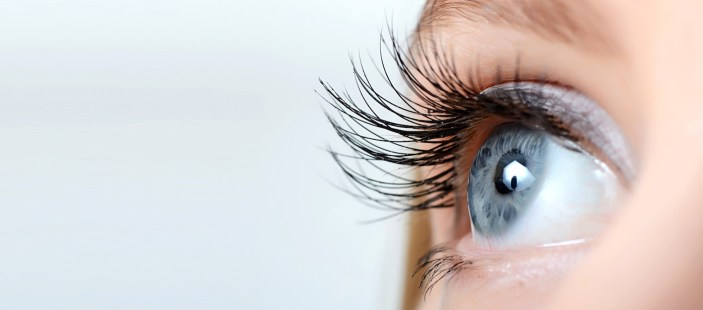 Female eye with long lashes and clear eyes