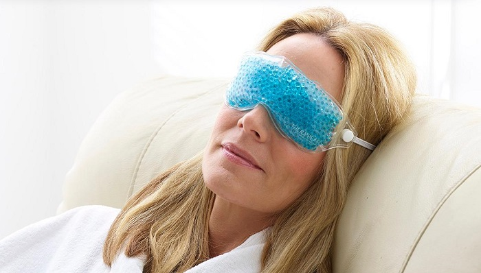 woman wearing a cold compress for the eyes