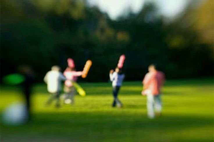 kids playing outdoors as seen through blurred lens