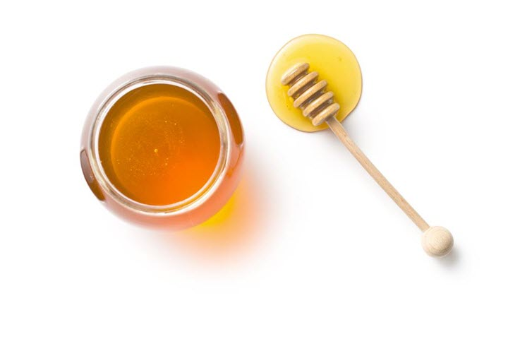 Honey dipper and honey in jar