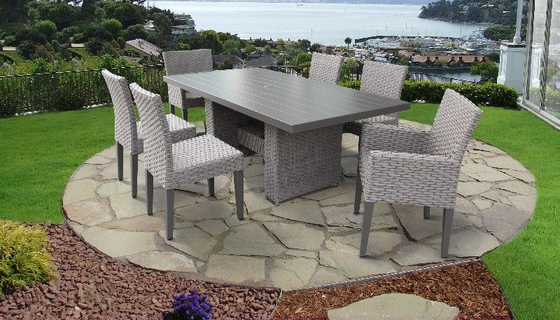 florence rectangular outdoor patio dining table w 4 armless chairs and 2 chairs w arms in grey stone tk classics florence dtrec kit 4adc2dc