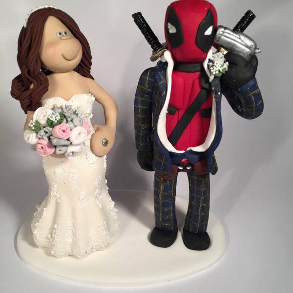 Themed Wedding Cake Toppers   Totally Toppers com This groom was a fan of the Deadpool film so dressed up as the character