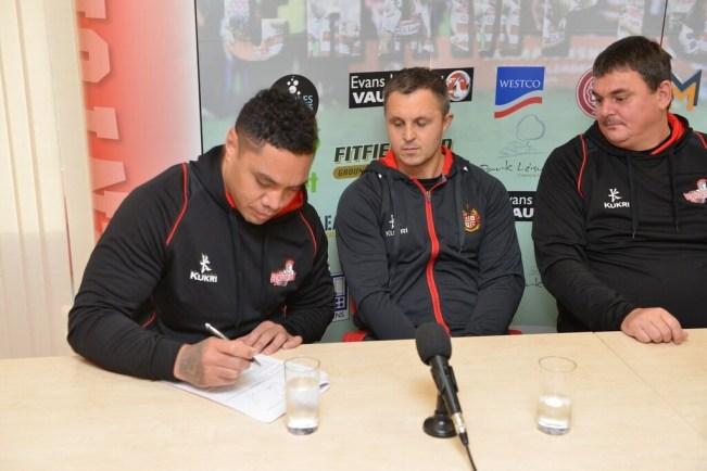 Tonga sings his new deal. Credit: Paul McCarthy