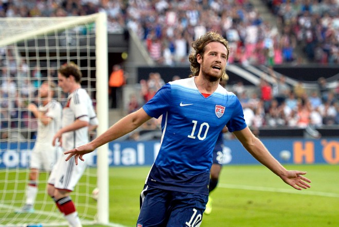 United States' Mix Diskerud celebrates after scoring his side's first goal during the soccer friendly match between Germany and the United States in Cologne, western Germany, Wednesday, June 10, 2015. (AP Photo/Martin Meissner)