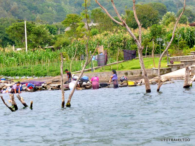 Leaving Santiago Atitlan on the banks of Lake Atitlan where women are washing their clothes by the lake