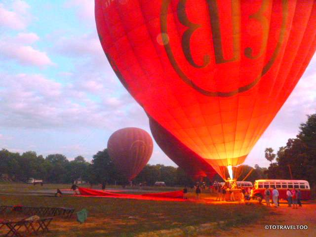 Enflating the balloon at sunrise in Bagan