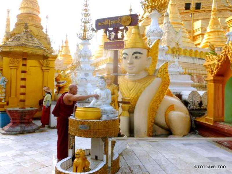 Washing the Buddha Statues at the Tuesday Corner at Shwedagon Pagoda