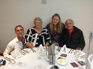 Saul and Rachel sitting at a table set for lunch, with new Touching Base life members, Elaine and Tony (Spag) Manitta