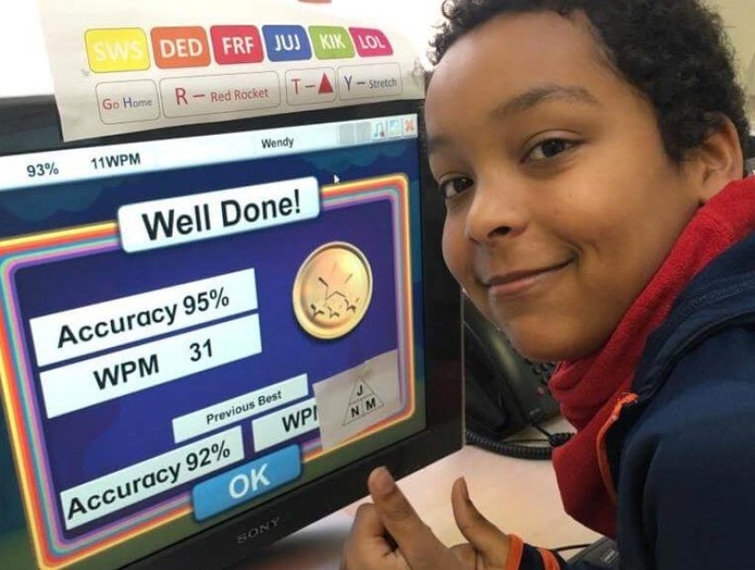 Child achieving success at touch typing