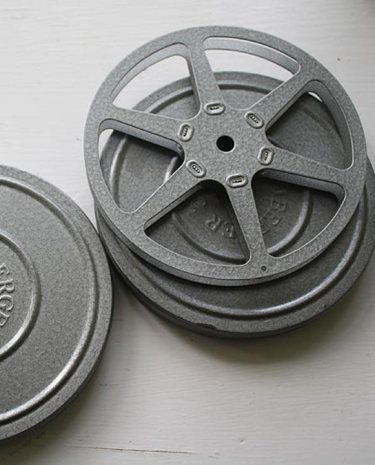 vintage reel and cannister set