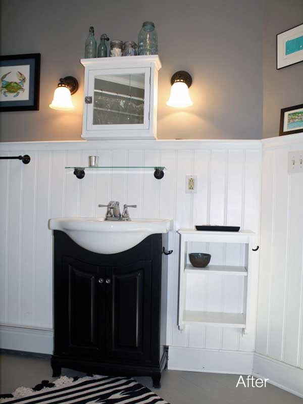 after view of renovated bathroom with new white wainscoting on walls with sink and medicine cabinet and shelf