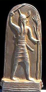 A typical depiction of Baal, with weapon raised and ceder limb