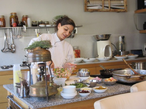 Touring Israel - At that point Tali began to put together the dishes. Here she was preparing ceviche.