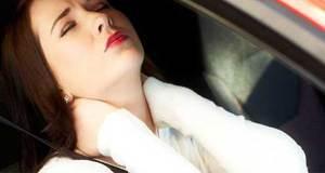 Female whiplash victim in car